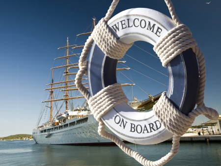 wiew on the sailing ship thru blue safe belt with welcome on board sign Standard-Bild