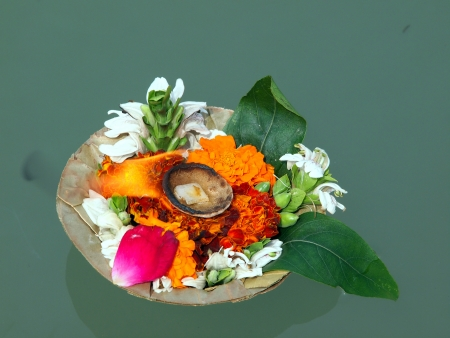 flowers and candle for the god wishes on the river ganges         photo