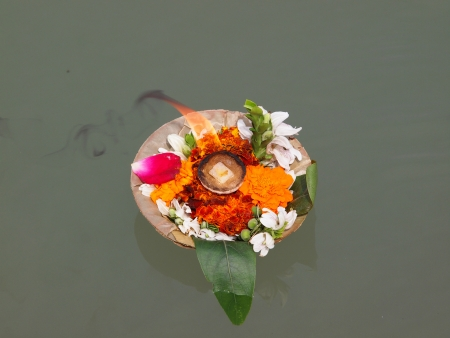 flowers and candles on the ganga river       photo