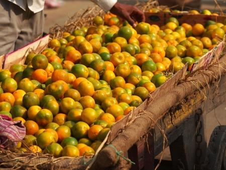 ambulant: oranges selling on the street of new delhi        Stock Photo