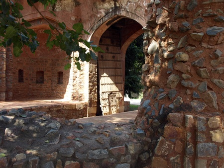 ruin and rotten wooden door on the tomb      photo