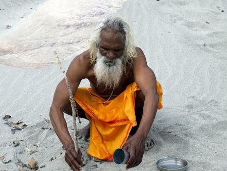 sadhu: sadhu cooking on the banks of ganges