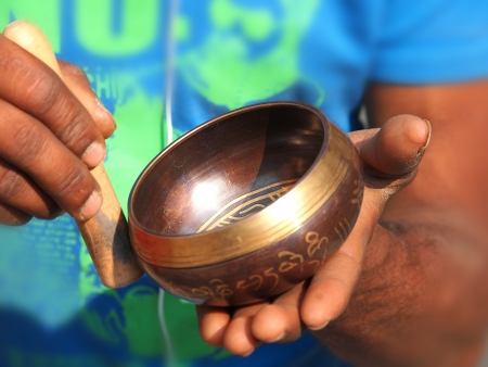 singing bowl in the hands of prayer        Stock Photo