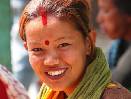 young girl from Nepal with red hear