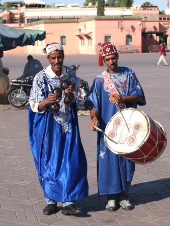 MARRAKESH - OCTOBER 17: Unidentified musicians in Jemaa el Fna Square at sunset, October 17, 2013 in a Marrakesh, Morocco. The square is part of the UNESCO World Heritage