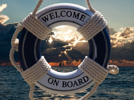 safe water:  view on the sailing ships in sunset through blue safe belt with welcome on board sign Stock Photo