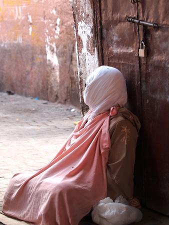 paranja: beggar on the street of Marrakesh,Morocco        Stock Photo