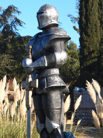 swordsman: statue of Knight Swordsman in Full Armour standing in front of  museum