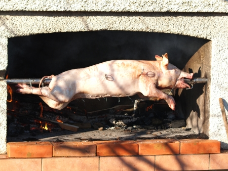 broach:   grilled pig on the broach         Stock Photo