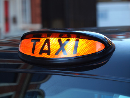 a british london black taxi cab sign  with colorful background