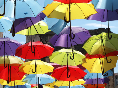 made in portugal: Lots of umbrellas coloring the sky in the city of Pula Croatia