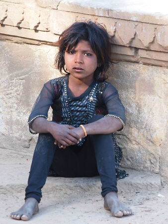 deprived: poverty, portrait of a poor little Indian girl