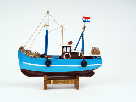 Model of wooden ship on a white background photo