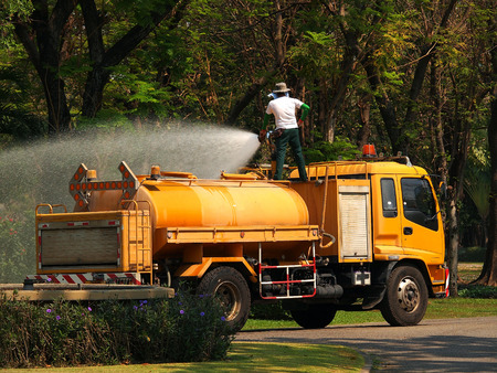 The water truck watering in the garden photo