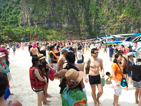 day trip: MAYA BAY, THAILAND - FEBRUARY, 2015: Crowds of visitors enjoy a day trip at Maya Bay, one of the iconic beaches of  Phi Phi  islands of Southern Thailand. Editorial