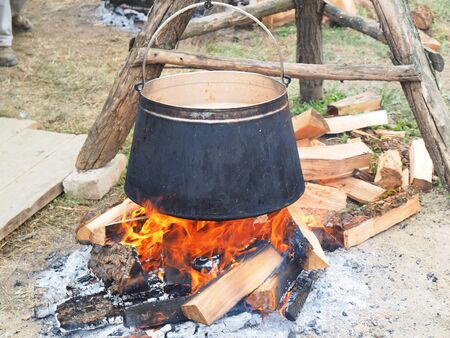 soup kettle: Tripod with kettle ready for cooking fish paprikas(dish caracteristic for Slavonija and Baranja)