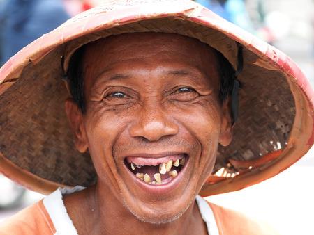 YOGYACARTA, JAVA -FEBRUARY 02 2016: Local weathered faced man with missing teeth smiling in the Yogyacarta,Java indonesia