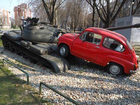 fico: Monument of  small red car smashing tank in Osijek , Mart 23, 2015 - Osijek,Slavonija,Croatia Editorial