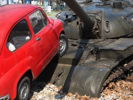 fico: small red car running over tank