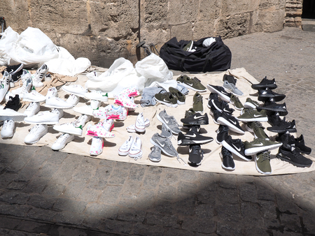 VALENCIA/SPAIN - 09 JUN 2017: Copies of popular brands of shoes sold on the Valencia street Фото со стока - 89961650