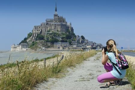 mont saint michel: Child photographed castle Le Mont-Saint-Michel Stock Photo