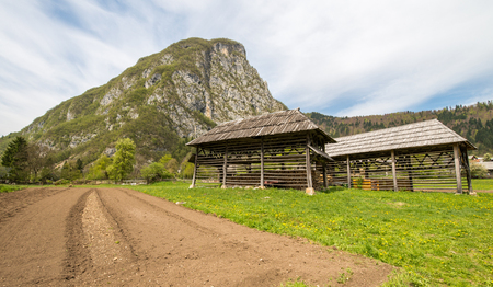 bohinj: Traditional wooden double hayrack in small village of Studor near Bohinj in Slovenia during spring time