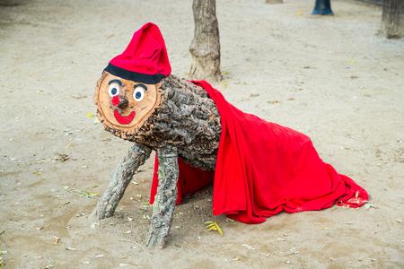 Red navidad woden mascot in Barcelona Banco de Imagens