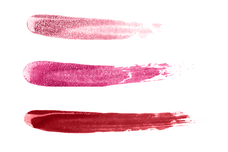Sparkling nail polish strokes isolated on white.