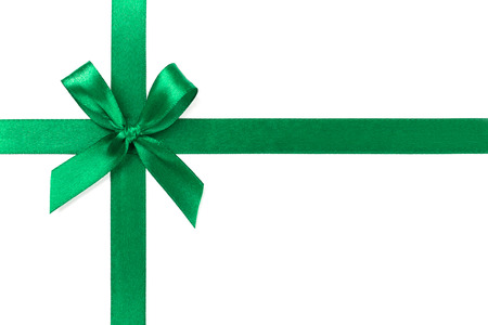 Beautiful green ribbon with bow isolated on white background.