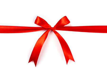 Beautiful red ribbon with bow isolated on white background. Stock Photo