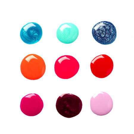 Set of sparkling colorful nail polish drops isolated on white.