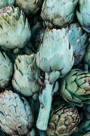 Fresh artichokes at farmers market. Top view. Archivio Fotografico