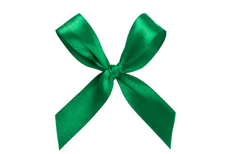 Green ribbon satin bow isolated on white background. Decoration concept.