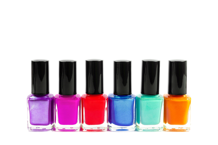 Set of colorful nail polish bottles isolated on white. Front view. Copy space for text. Stock Photo