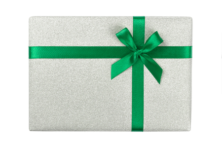 Light gray glitter gift box with satin green ribbon isolated on white. Christmas, holidays and celebration concept. Stock Photo