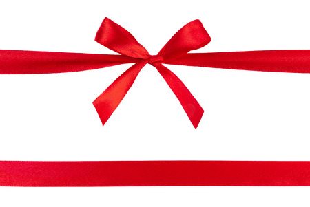 Beautiful red ribbon with bow isolated on white background. Reklamní fotografie