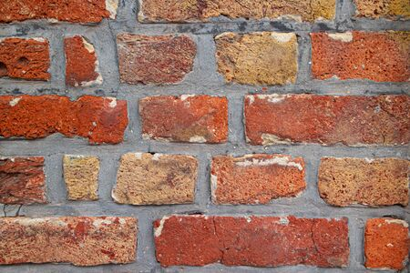 Brick wall of red color, closeup of masonry. Textured background.