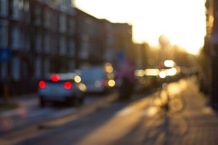 Abstract background of blurred street view in sunset light.