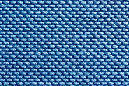 Blue abstract fabric texture background. Copyspace for text.