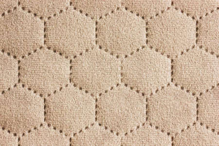 Beige abstract fabric texture background. Copyspace for text.