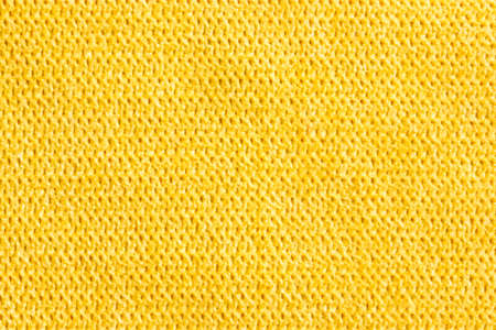 Yellow abstract fabric texture background. Copyspace for text.