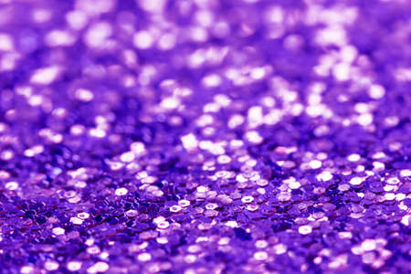 Abstract festive purple background. Blurred glitter texture.