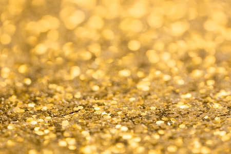 Abstract festive gold background. Blurred glitter texture.