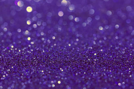 Abstract purple blue background with bokeh effect. Blurred glitter.