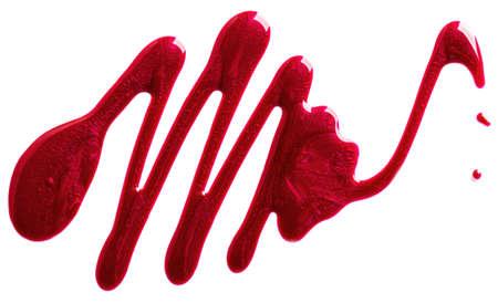Red glitter nail polish splash isolated on white background. Reklamní fotografie