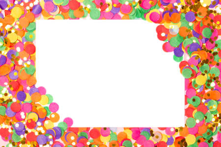 Festive background with blank white paper card on colorful confetti. Holiday or Invitation concept. Place for text. Flat lay, view from above.