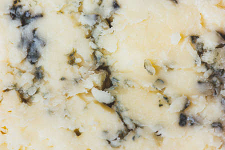Close up of blue cheese texture. Abstract food background.