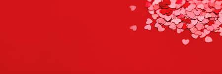 Beautiful festive with red metallic heart shaped confetti.