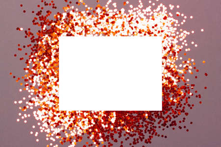 Mockup of greeting card on festive background with sparkling confetti. Holiday or Invitation concept. Place for text. Flat lay, view from above.