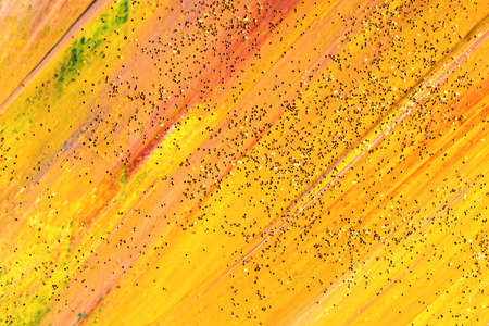 Abstract sparkling painted background in yellow colors.